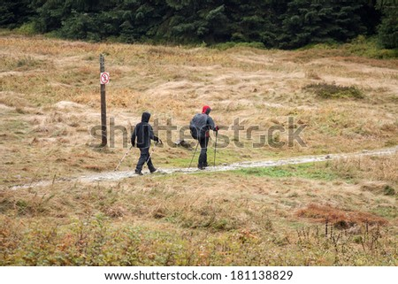 two people wandering the mountains