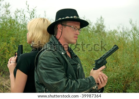 Two people with guns, duel - stock photo