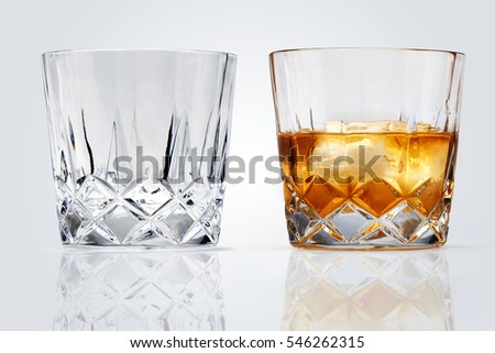 Two Perfect glasses of whiskey and ice isolated on white background. Clipping path