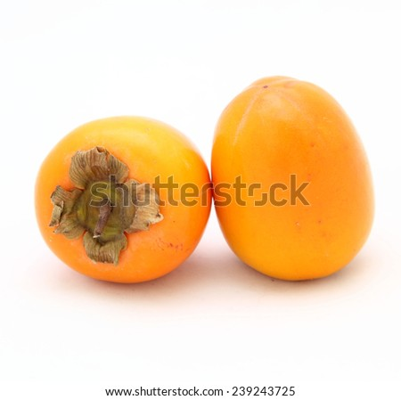 two persimmon on a white background - stock photo