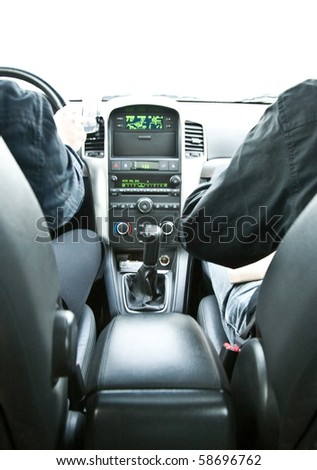 two persons hand in black dressed in luxury car driving with control panel - stock photo