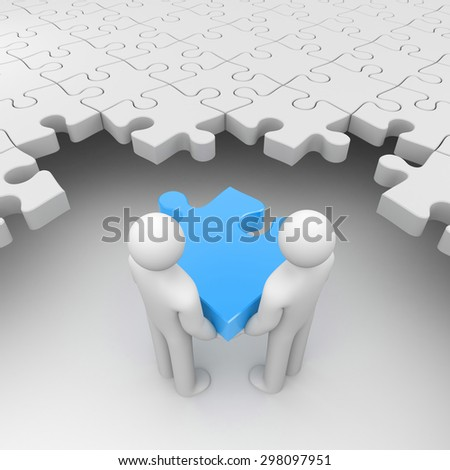 Two persons holding blue puzzle surrounded by white puzzles - stock photo