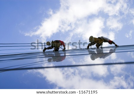 Two persons washing windows extremely high - stock photo
