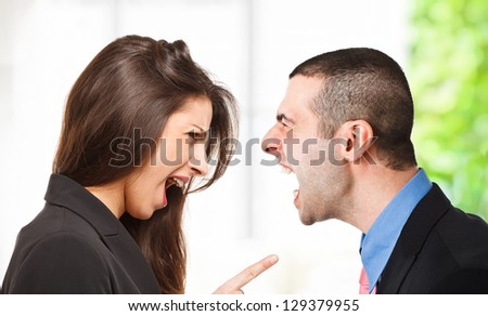 Two persons yelling out to each other - stock photo