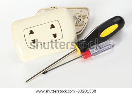 Two Peruvian plastic sockets with philips-head screwdrivers on white (Selective Focus, Focus on the socket) - stock photo