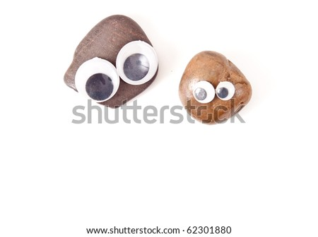 Two Pet Rocks with Fun Little Eyes - stock photo