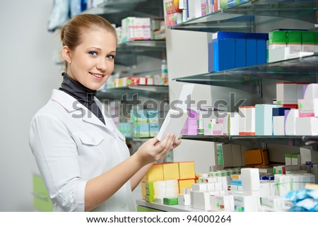 two pharmacist chemist women working in pharmacy drugstore - stock photo