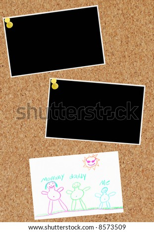 two photos and child family drawing on corkboard - stock photo