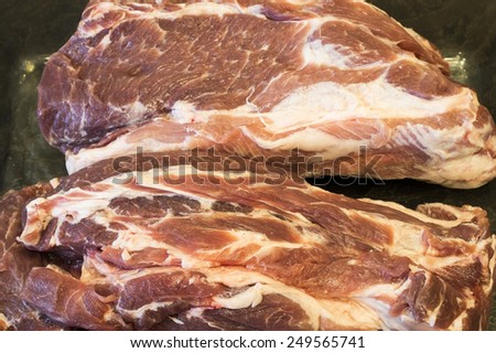 Two pieces of a pork neck before preparation - stock photo