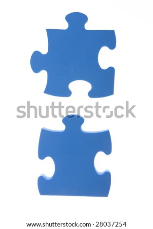 two pieces of blue puzzle - stock photo