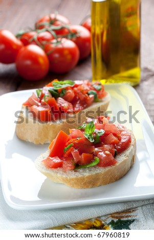 two pieces of bruschetta on plate - stock photo