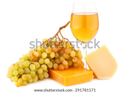 Two pieces of cheese, grapes and glass of wine isolated on white background. - stock photo