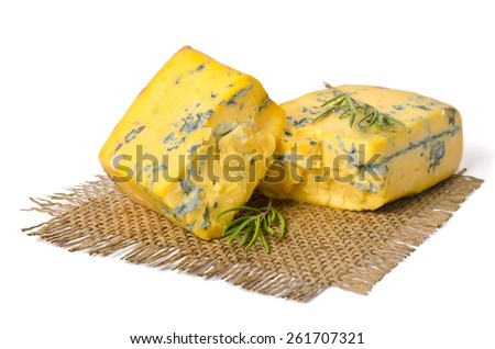 two pieces of cheese on a napkin isolated on white background - stock photo