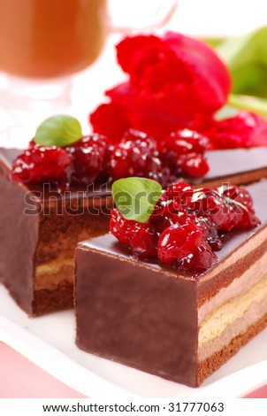 two pieces of chocolate cake with cherry