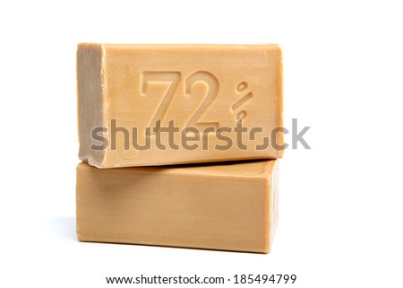 Two pieces of economic simple natural soap isolated on white background. - stock photo