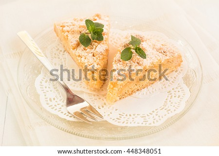 Two pieces of fresh baked apple crumble cake lying on a plate