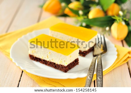 Two pieces of orange mascarpone quark cake (cheesecake), copy space for your text - stock photo
