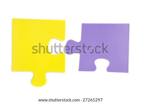 Two pieces of puzzle isolated over white - stock photo