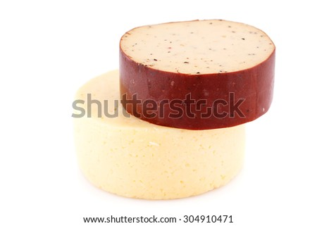 Two pieces of round cheese isolated on white background. - stock photo