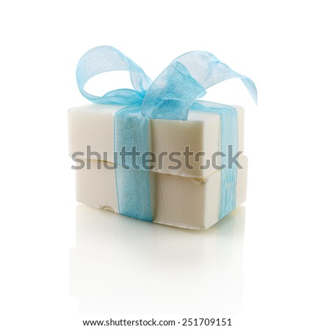 Two pieces of soap, tied with a blue ribbon with a bow on a white background. Isolated with clipping path. - stock photo