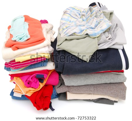Two piles of family laundry - stock photo