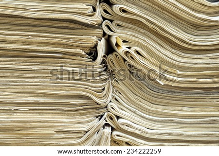 Two piles of old newspapers for recycling - stock photo