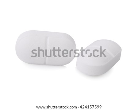two pills on white background