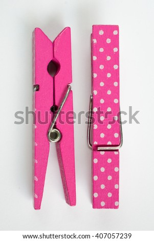 Two Pink Clothes Pins with Fun Patterns One Flipped Top View