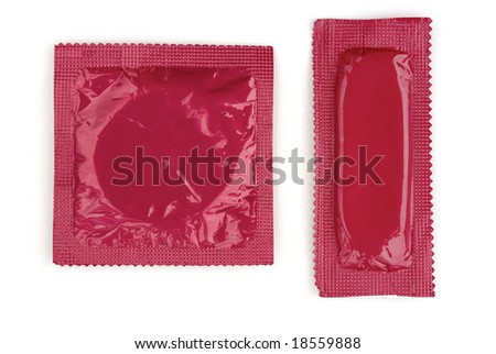 Two pink condom wrappers in square and rectangle packaging on white background - stock photo