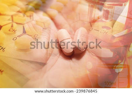 Two pink pills in arm. Macro image. - stock photo
