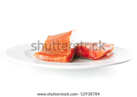 two pink salmon bit on a big white dish