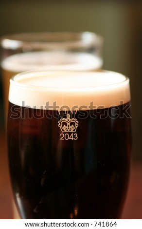 two pints of beer - shallow depth of field - stock photo