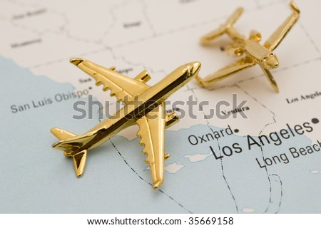 Two Planes Over Los Angeles. Map is Copyright and Trademark Free, Downloaded off www.nationalatlas.gov - stock photo