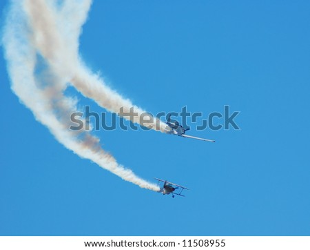 two planes performing in an air show - stock photo