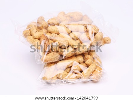Two plastic bags of peanuts on the white background