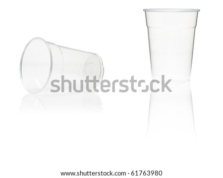 Two plastic cups with reflection on white background