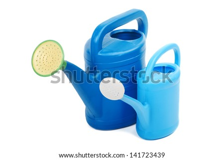 Two plastic watering cans isolated on a white background - stock photo