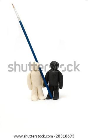 Two Plasticine men hold a brush - stock photo
