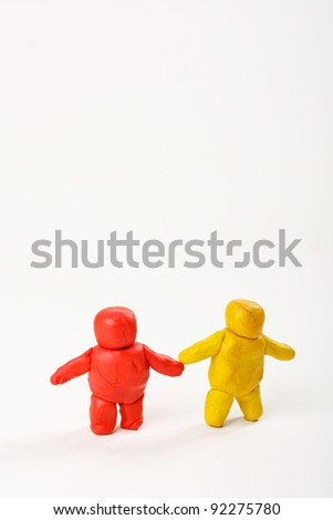 Two Plasticine men. standing isolated on white background - stock photo
