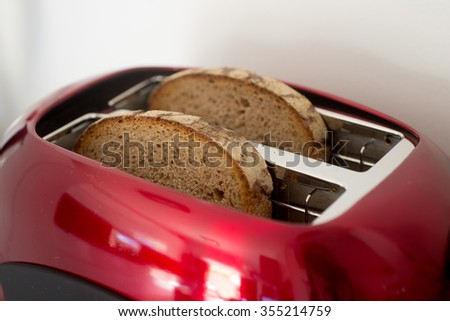 Two plates of bread in the modern reg toaster - stock photo