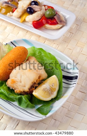 Two plates with Fried Cob and Rinforzo Salad