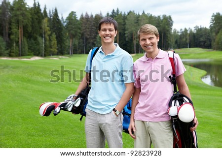 Two players on the golf course - stock photo