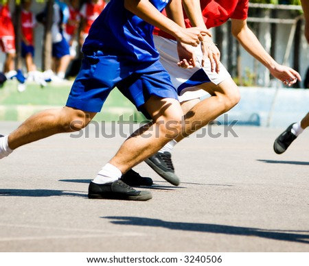 Two Players running for the ball. - stock photo