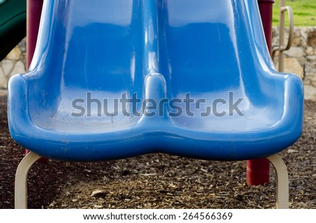 Two playground slides side by side - stock photo