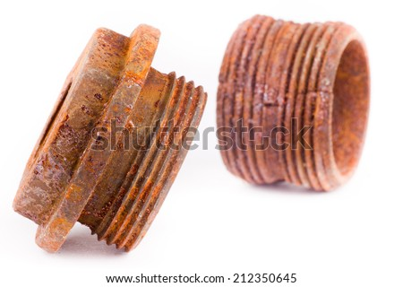 Two plumbing fittings with orange rust isolated on white background - stock photo