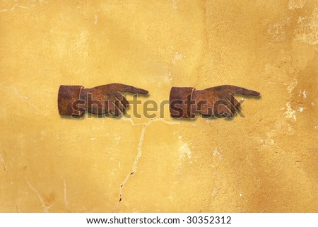 two pointing hands on wall - stock photo