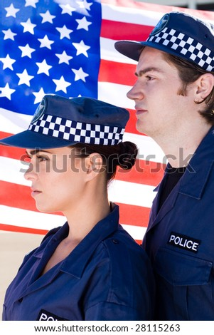 two police officer standing in front of american flag
