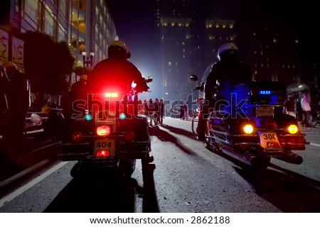 Two Police Officers On Motorcycles In A Night City. - stock photo