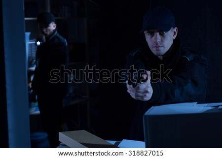 Two policemen at work on the intervention - stock photo