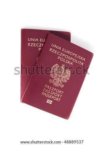 Two Polish passports on a white background. - stock photo